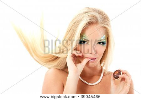 portrait of mermaid beautiful magic mythology young woman with licks her finger with sweet candy isolated on white background
