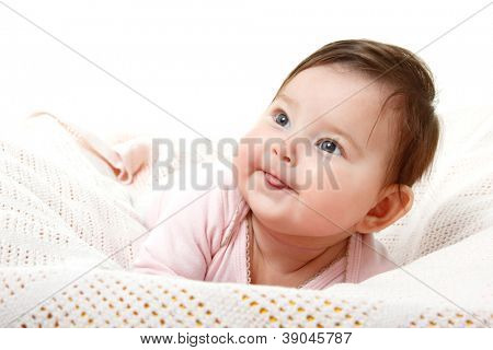 cute funny infant baby looking up in left corner smiling and show tongue, beautiful kid's face closeup with copyspace over white