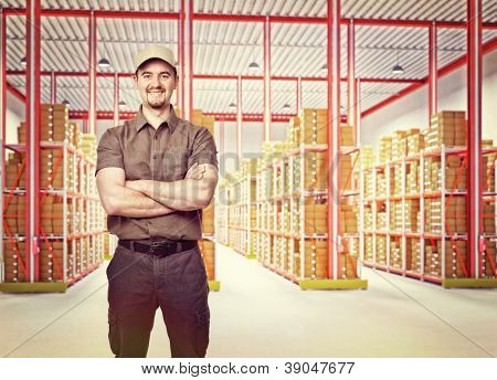 smiling delivery man in classic warehouse