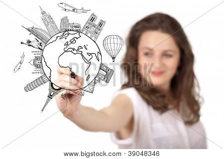 Young woman drawing a globe on whiteboard isolated on white