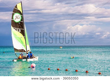 VARADERO,CUBA-NOVEMBER 3:Family of tourists sailing November 3,2012 in Varadero.With over a million visitors per year,Varadero is the main destination for the growing cuban tourism industry