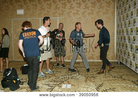 SAN DIEGO, CA - JULY 15: Members of the press chat with Matt Smith as he arrives at the 2012 Comic Con convention press room at the Bayfront Hilton Hotel on Sunday, July 15, 2012 in San Diego, CA.