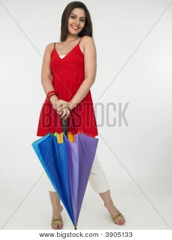 Woman With A Closed Rainbow Umbrella