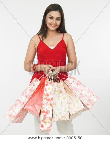Female With Many Shopping Bags