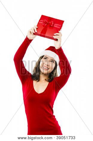 Beautiful asian woman wearing Santa's hat and holding a christmas gift, isolated on white
