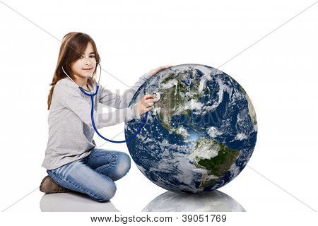 Portrait of a little girl auscultate the health of the planet earth with a stethoscope, isolated on white background
