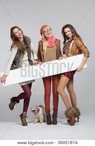 Three smiling girl