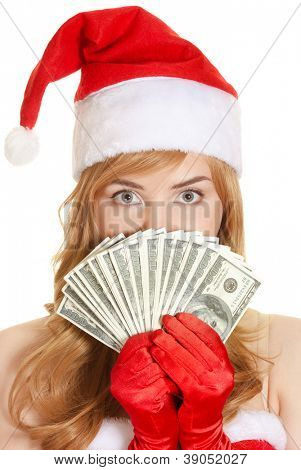 Christmas woman holding dollars banknotes wearing Santa hat