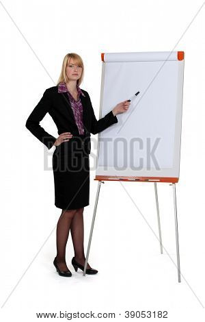 businesswoman pointing at paperboard with marker