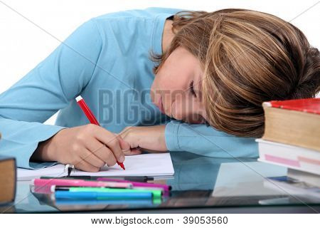 Tired child doing homework