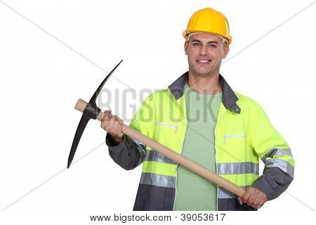 portrait of worker holding pickaxe