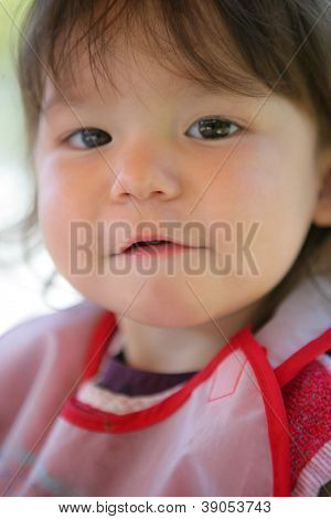 Little girl wearing a bib