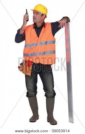 foreman standing in studio using talkie walkie