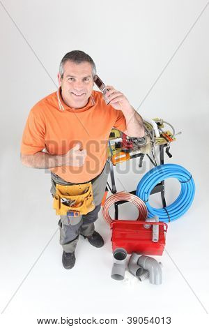 full-length portrait of experienced craftsman making a call