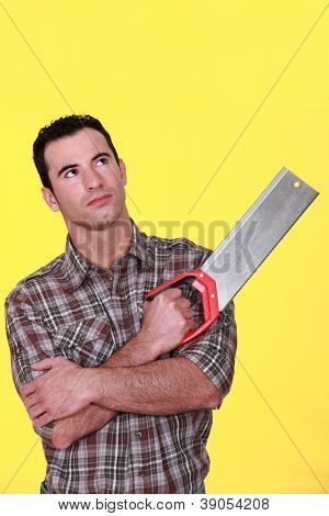 Man holding a saw