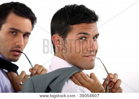 two sexy businessmen posing