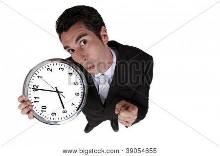 High-angle shot of a businessman holding a clock