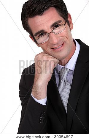 businessman leaning his head on his fist