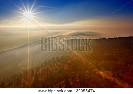 View on the sun over inversion from Jested, Jested-Kozakov ridge, Czech Republic
