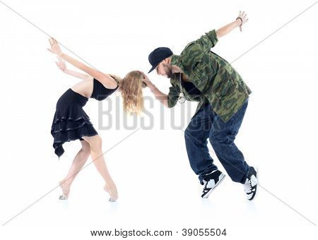 Gymnast and rapper stand on tiptoe, arms tossed back isolated on white background. Man keeps head of woman.
