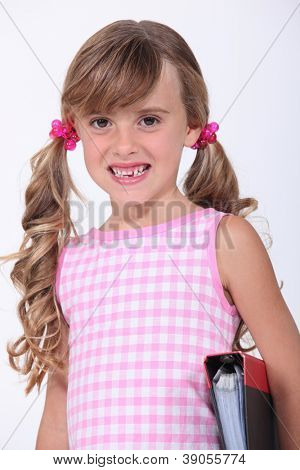 Young schoolgirl showing her teeth