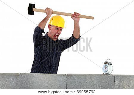Tradesman about to smash an alarm clock