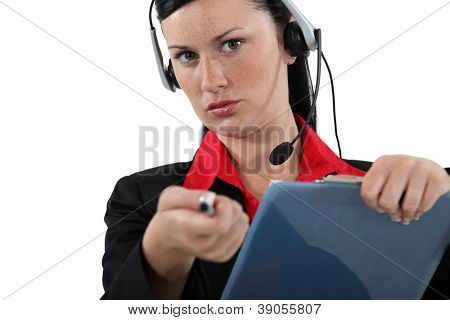 Woman with a headset and clipboard
