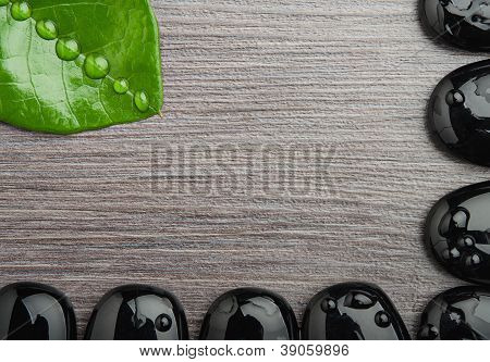 Spa Background Wooden With Frame Of Stones And Leaf With Water Droplets, Space Empty
