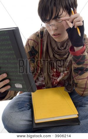 Student Posing With Eyewear And Books