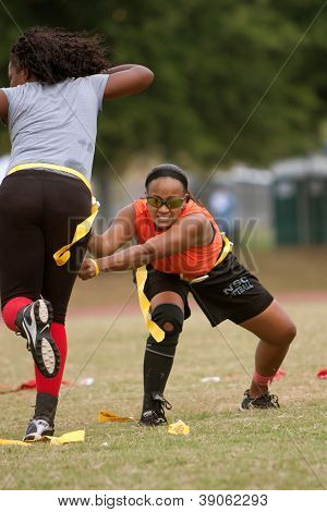 Woman Practices Flag Football Techniques