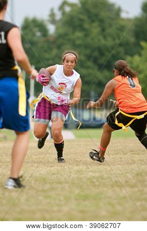 Female Flag Football Player Dodges Defenders
