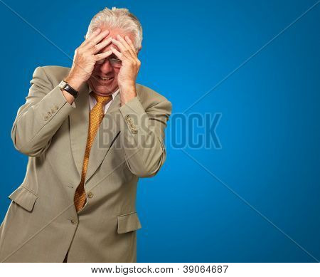 Senior Business Man In Tension Isolated On Blue Background