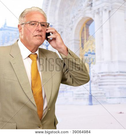 Mature Business Man Talking On Cell Phone, Outdoors