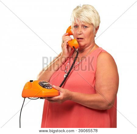 Portrait Of A Senior Woman Holding A Retro Phone On White Background