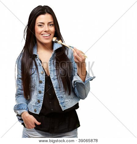 Young Woman Holding A Piece Of Sushi With Chopsticks On White Background
