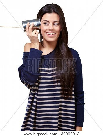 Female Holding A Metal Tin As A Telephone On A White Background
