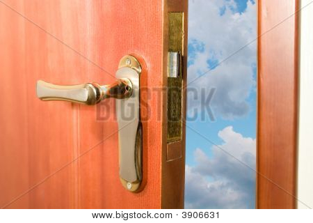 Door Opening To The Blue Sky With Clouds