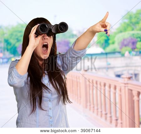 Portrait Of A Young Woman Looking Through Binoculars, Outdoors