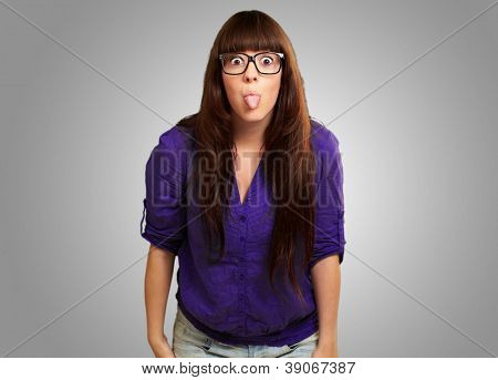 Crazy Woman With Stick Out Tongue Isolated On Gray Background