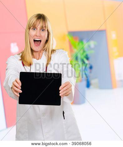 surprised doctor holding a digital tablet, indoor