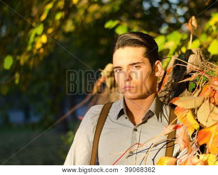 Portrait of handsome young man  in fall (autumn)