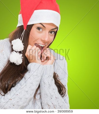 Christmas woman waiting for her gift against a green background