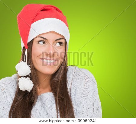 Happy christmas woman looking up against a green background
