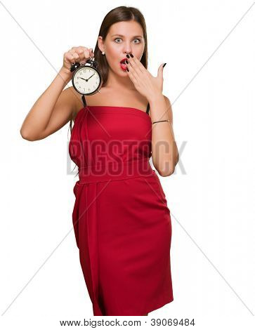 Shocked Woman Holding Alarm Clock On White Background