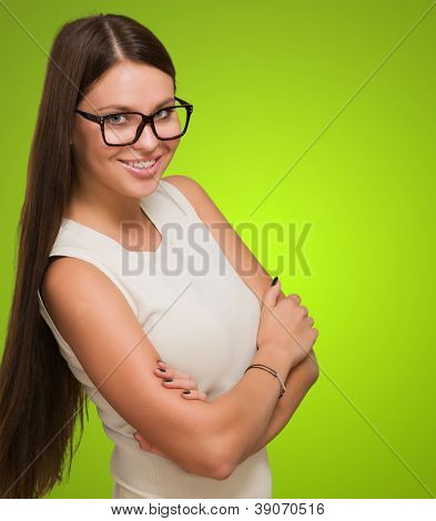 Happy Woman wearing glasses against a green background