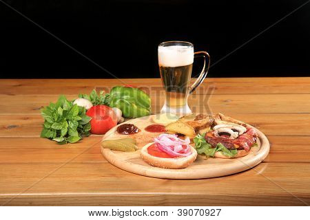 Beef Burger On A Plate With Vegetables