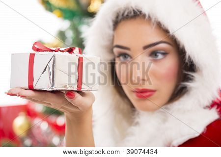 Beautiful Santa Girl Holding Gift Box