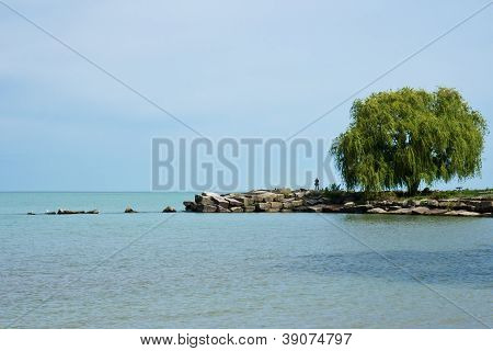 Fisherman On A Breakwall