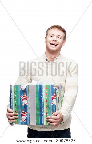 young happy man holding big heavy gift