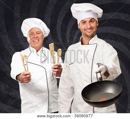 Portrait Of Two Happy Chef On Wallpaper, Indoor